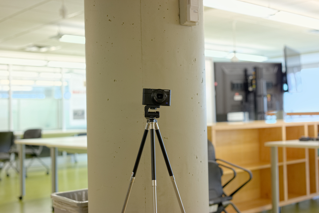 a picture of a point and shoot camera mounted on a small tripod.