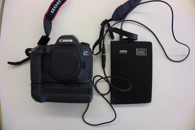 A camera connected to an external battery.