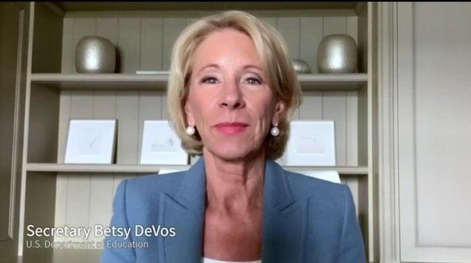 An image from a remote television appearance by Betsy DeVos.